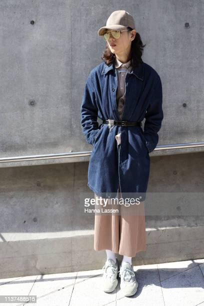 Guest wearing mirrored sunglasses denim coat beige wide pants and Adidas sneakers is seen at the Hera Seoul Fashion Week 2019 F/W at Dongdaemun...