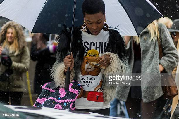 A guest wearing Moschino shirt and phone case seen outside Jeremy Scott during New York Fashion Week Women's Fall/Winter 2016 on February 15 2016 in...