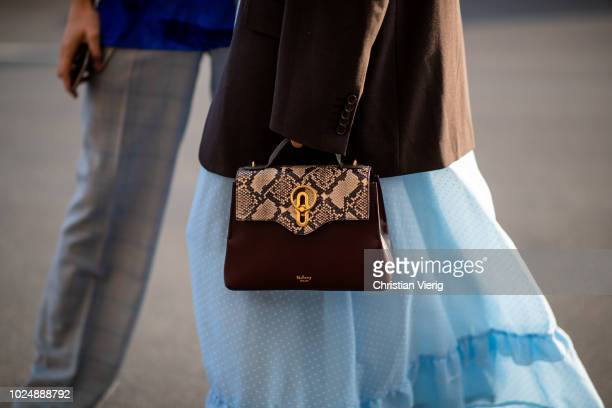 Guest wearing Mulberry bag is seen during Stockholm Runway SS19 on August 28, 2018 in Stockholm, Sweden.