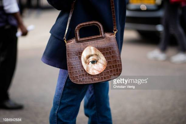 A guest wearing Mulberry bag is seen outside Simone Rocha during London Fashion Week September 2018 on September 16 2018 in London England