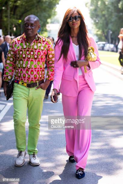 Guest wearing multicolored shirt and pink suit are seen in the streets of Milan after the Giorgio Armani show during Milan Men's Fashion Week...