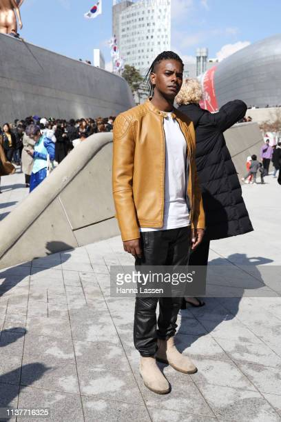 Guest wearing mustard leather jacket is seen at the Hera Seoul Fashion Week 2019 F/W at Dongdaemun Design Plaza at Dongdaemun Design Plaza on March...