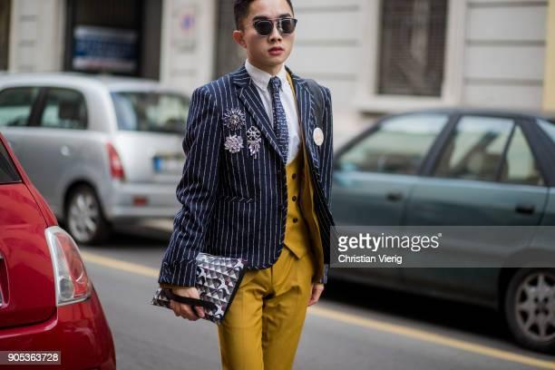 A guest wearing mustard suit striped blazer jacket is seen outside No21 during Milan Men's Fashion Week Fall/Winter 2018/19 on January 15 2018 in...