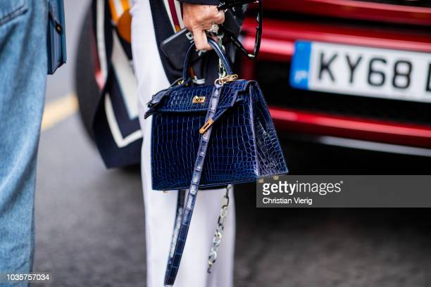 A guest wearing navy blue Hermes bag is seen outside Natasha Zinko during London Fashion Week September 2018 on September 18 2018 in London England