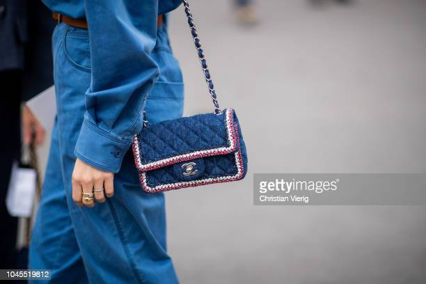 A guest wearing navy Chanel bag is seen outside Chanel during Paris Fashion Week Womenswear Spring/Summer 2019 on October 2 2018 in Paris France