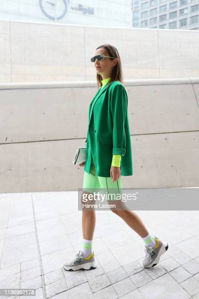 Guest wearing neon green sunglasses bike shorts and sneakers is seen at the Hera Seoul Fashion Week 2019 F/W at Dongdaemun Design Plaza at Dongdaemun...
