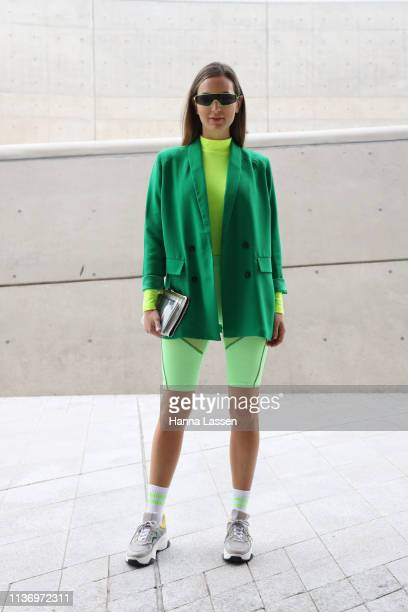 Guest wearing neon green sunglasses, bike shorts and sneakers is seen at the Hera Seoul Fashion Week 2019 F/W at Dongdaemun Design Plaza at...