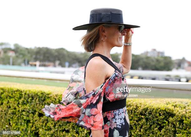 A guest wearing NERIDA WINTER boater RayBan sunglasses and Alice McCALL dress at TAB Epsom Day at Royal Randwick Racecourse on September 30 2017 in...