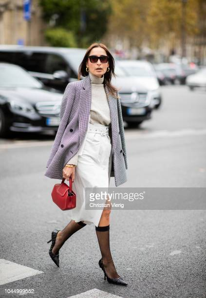 A guest wearing net socks is seen outside Miu Miu during Paris Fashion Week Womenswear Spring/Summer 2019 on October 2 2018 in Paris France