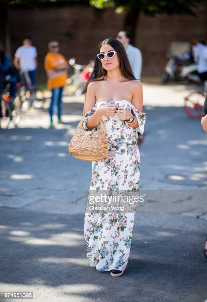 A guest wearing off shoulder dress with floral print basket bag is seen during the 94th Pitti Immagine Uomo on June 14 2018 in Florence Italy