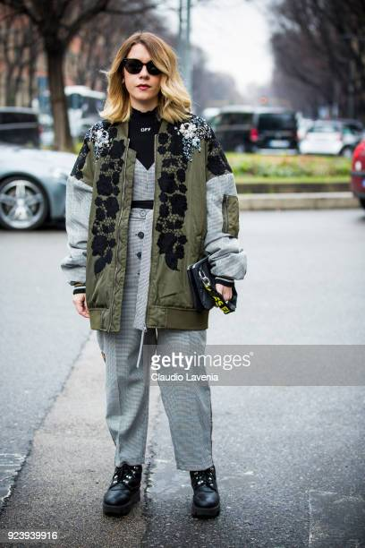 Guest wearing Off White shirt and bag is seen outside Giorgio Armani show during Milan Fashion Week Fall/Winter 2018/19 on February 24 2018 in Milan...