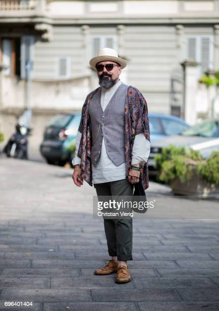 A guest wearing olive pants hat vest is seen during Pitti Immagine Uomo 92 at Fortezza Da Basso on June 15 2017 in Florence Italy