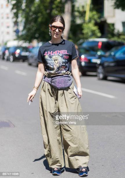 A guest wearing olive wide leg pants Chanel tshirt is seen outside Damir Doma during Milan Men's Fashion Week Spring/Summer 2018 on June 18 2017 in...