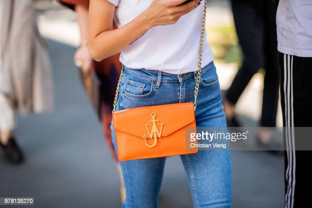 A guest wearing orange JW Anderson bag is seen outside Fendi during Milan Men's Fashion Week Spring/Summer 2019 on June 18 2018 in Milan Italy