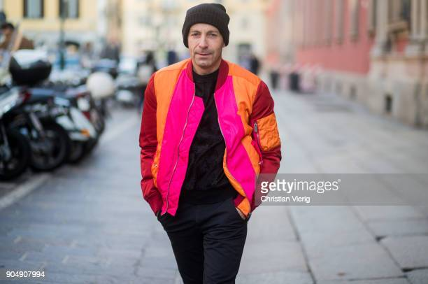 A guest wearing orange pink bomber jacket beanie is seen outside MSGM during Milan Men's Fashion Week Fall/Winter 2018/19 on January 14 2018 in Milan...