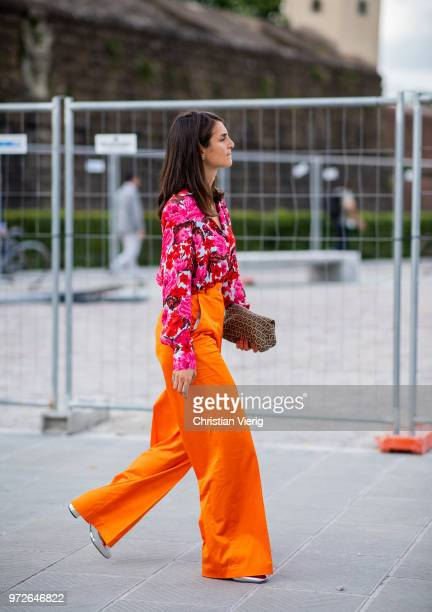 A guest wearing orange wide leg pants is seen during the 94th Pitti Immagine Uomo on June 12 2018 in Florence Italy