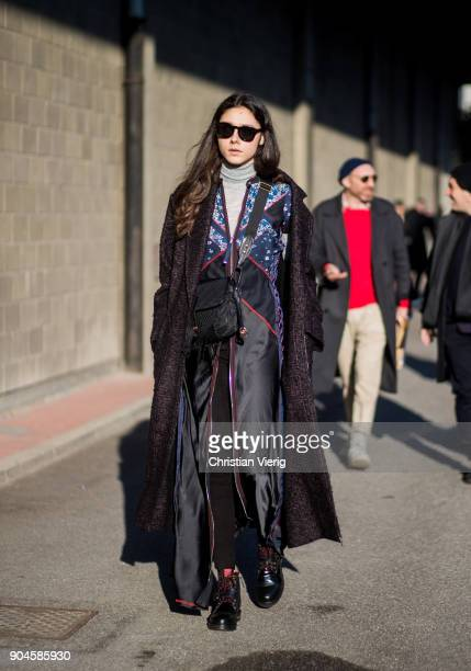 A guest wearing overall belt bag is seen outside Diesel during Milan Men's Fashion Week Fall/Winter 2018/19 on January 13 2018 in Milan Italy
