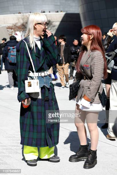 Guest wearing oversized green check trench with white belt and mini bag is seen at the Hera Seoul Fashion Week 2019 F/W at Dongdaemun Design Plaza at...