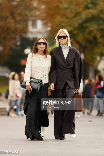 Guest wearing oversized suit outside Rochas on September 25, 2019 in Paris, France.