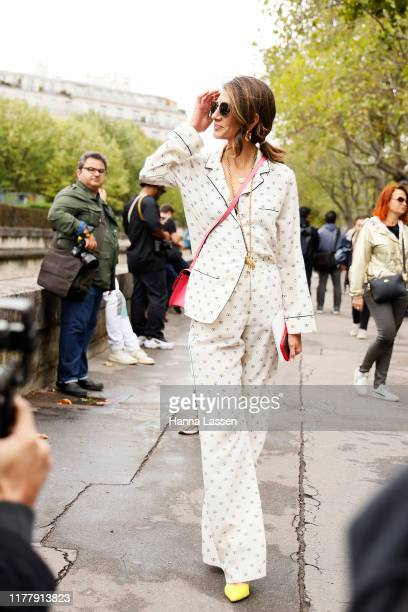 A guest wearing Pajama set outside Valentino during Paris Fashion Week Womenswear Spring Summer 2020 on September 29 2019 in Paris France