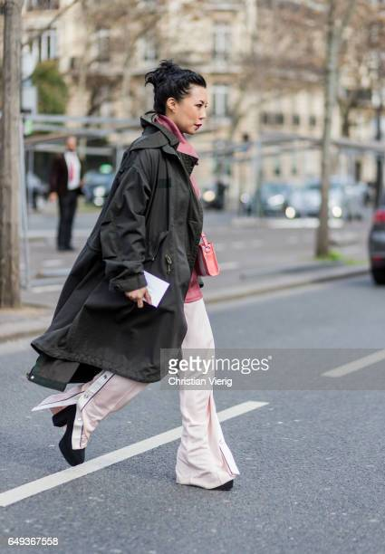A guest wearing parka and flared pants outside Ellery on March 7 2017 in Paris France
