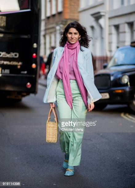 A guest wearing pastel colors seen outside Mulberry during London Fashion Week February 2018 on February 16 2018 in London England