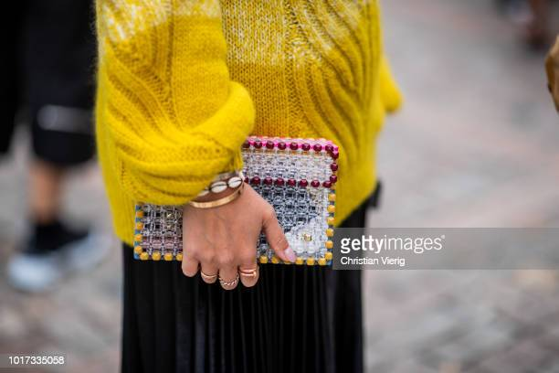 A guest wearing pearl bag is seen outside Moire during Oslo Runway SS19 on August 15 2018 in Oslo Norway