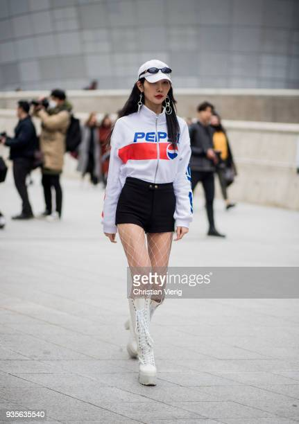 A guest wearing Pepsi track suit jacket white cap is seen at the Hera Seoul Fashion Week 2018 F/W at Dongdaemun Design Plaza on March 21 2018 in...