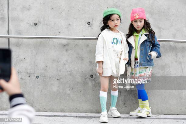 Guest wearing pink beanie denim jacket and white sneakers is seen at the Hera Seoul Fashion Week 2019 F/W at Dongdaemun Design Plaza at Dongdaemun...
