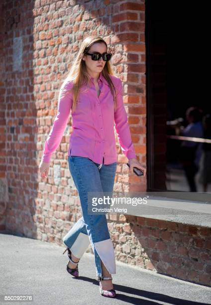 A guest wearing pink blouse two tone denim jeans is seen outside Gucci during Milan Fashion Week Spring/Summer 2018 on September 20 2017 in Milan...