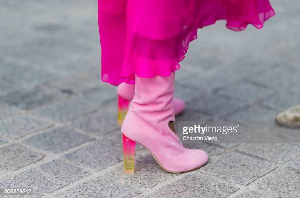 A guest wearing pink boots outside Schiaparelli during Paris Fashion Week Haute Couture Fall/Winter 20172018 Day Two on July 3 2017 in Paris France