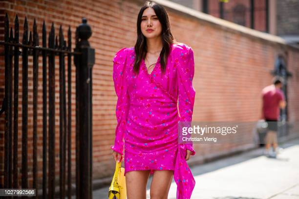 A guest wearing pink dress yellow bag is seen outside Collina Strada during New York Fashion Week Spring/Summer 2019 on September 6 2018 in New York...