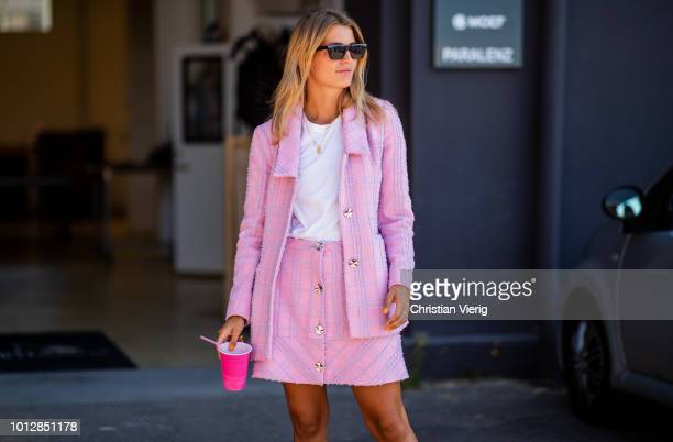 A guest wearing pink jacket and skirt seen outside Resume during the Copenhagen Fashion Week Spring/Summer 2019 on August 7 2018 in Copenhagen Denmark