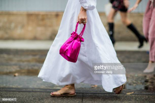 A guest wearing pink sack bag sandals during MercedesBenz Fashion Week Resort 19 Collections at Carriageworks on May 14 2018 in Sydney Australia