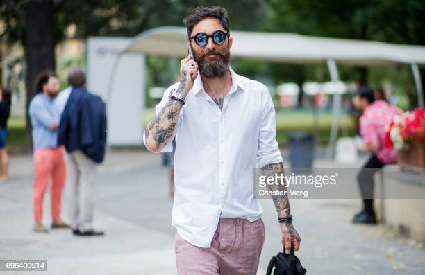 A guest wearing pink shorts and backpack is seen during Pitti Immagine Uomo 92 at Fortezza Da Basso on June 15 2017 in Florence Italy