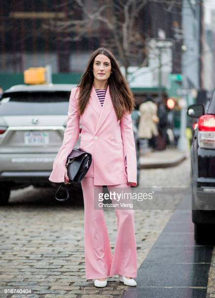 A guest wearing pink suit black Chloe bag seen outside Dion Lee on February 10 2018 in New York City