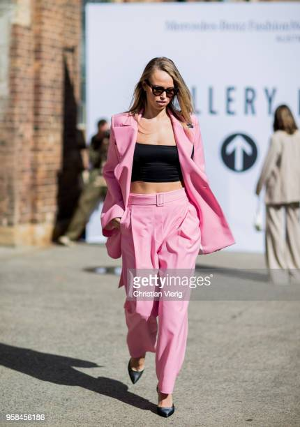A guest wearing pink suit black cropped top during MercedesBenz Fashion Week Resort 19 Collections at Carriageworks on May 14 2018 in Sydney Australia