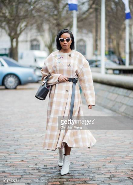 A guest wearing plaid coat seen outside Natasha Zinko during London Fashion Week February 2018 on February 20 2018 in London England