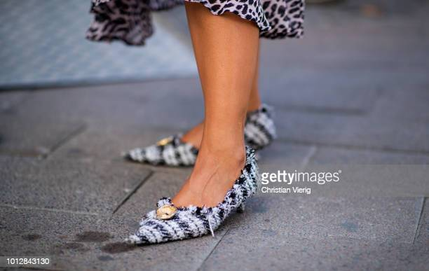 A guest wearing pointed heels is seen outside Blanche during the Copenhagen Fashion Week Spring/Summer 2019 on August 7 2018 in Copenhagen Denmark
