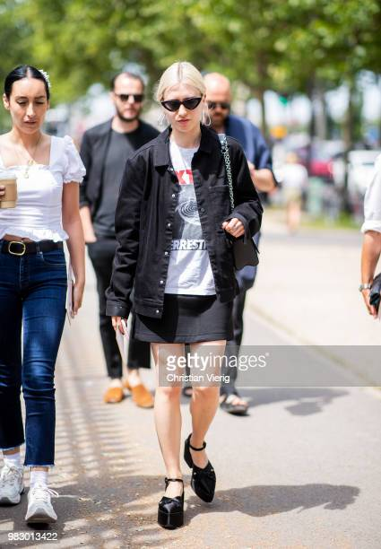 A guest wearing pointed platform shoes is seen outside Balmain on day six of Paris Fashion Week Menswear SS19 on June 24 2018 in Paris France