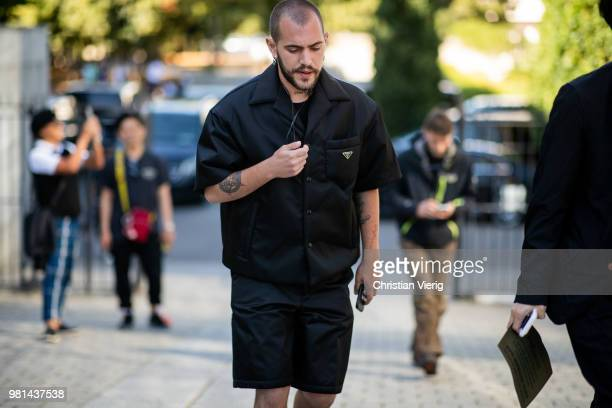 A guest wearing Prada jacket with short sleeves and shorts is seen outside Junya Watanabe Man on day four of Paris Fashion Week Menswear SS19 on June...