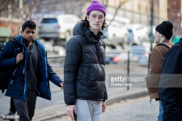A guest wearing puffer jacket is seen during Mens' New York Fashion Week on February 6 2018 in New York City