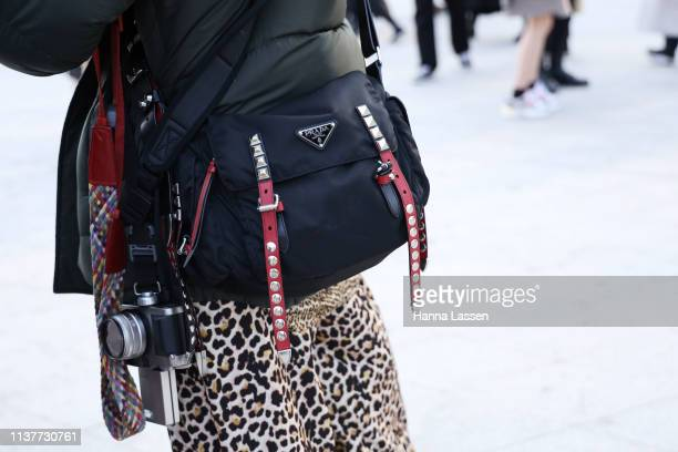 Guest wearing puffer jacket leopard skirt and Prada camera bag is seen at the Hera Seoul Fashion Week 2019 F/W at Dongdaemun Design Plaza at...