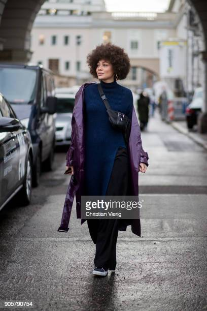 A guest wearing purple coat black belt bag is seen outside Der Berliner Modesalon during the Berlin Fashion Week January 2018 on January 16 2018 in...