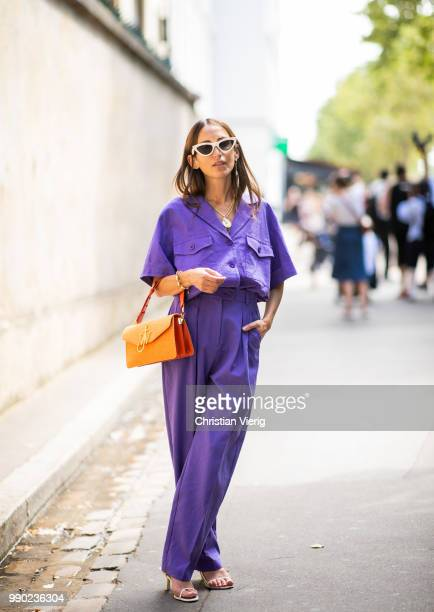 A guest wearing purple pants and button shirt seen outside Dior on day two during Paris Fashion Week Haute Couture FW18 on July 2 2018 in Paris France