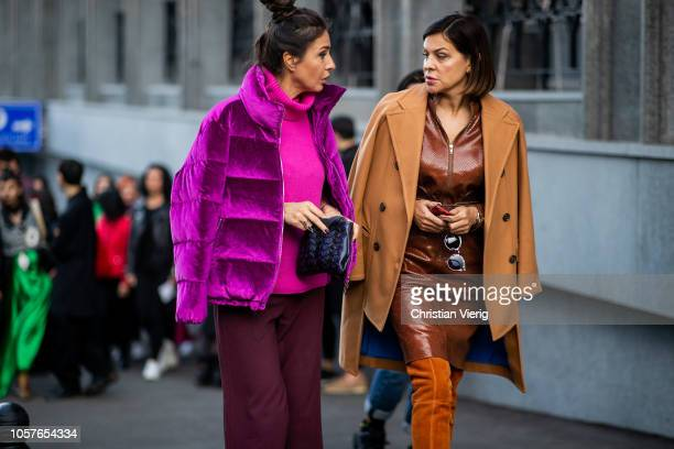 A guest wearing purple turtleneck and jacket and a guest wearing a brown coat brown dress seen during MercedesBenz Tbilisi Fashion Week on November 5...