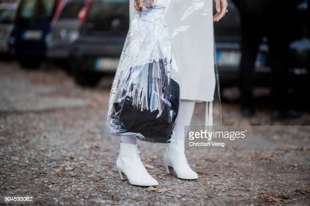 A guest wearing Raf Simons bag plastic dress is seen outside Marni during Milan Men's Fashion Week Fall/Winter 2018/19 on January 13 2018 in Milan...