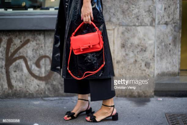 A guest wearing red bag is seen outside Blumarine during Milan Fashion Week Spring/Summer 2018 on September 23 2017 in Milan Italy