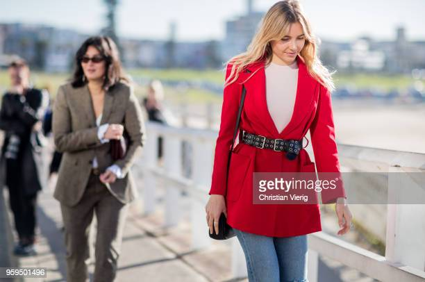 A guest wearing red belted blazer jacket during MercedesBenz Fashion Week Resort 19 Collections at Icebergs Dining Room on May 17 2018 in Sydney...