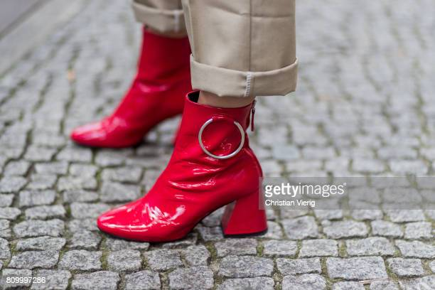 Guest wearing red boots during the Mercedes-Benz Fashion Week Berlin Spring/Summer 2018 at Kaufhaus Jandorf on July 6, 2017 in Berlin, Germany.